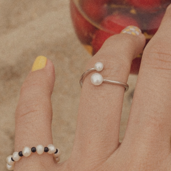 Pearl and simple open ring