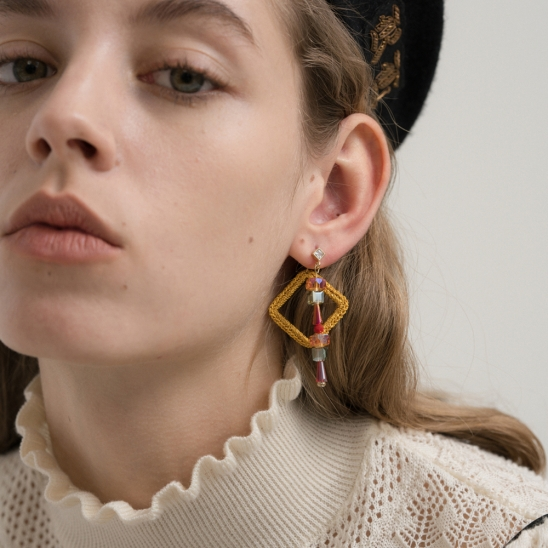 Golden knit frame with medieval crystal earring